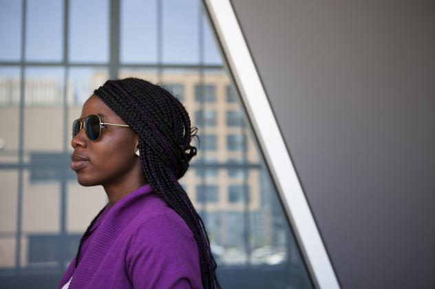 Sa'a, a pseudonym she uses for her safety, poses for a photo after an interview with NPR. She was one of more than 250 girls kidnapped in Nigeria by Boko Haram in 2014. Sa'a, 20, escaped by jumping off a moving truck. She began studying at a college in t