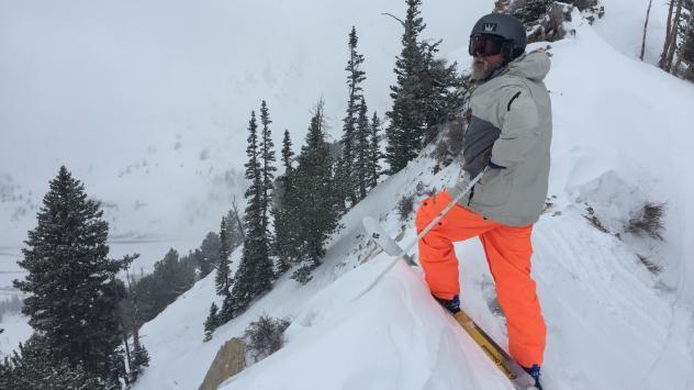 A skier gets ready to plunge down Alta Ski Area's extreme run, Eddie's High Nowhere. The resort has banned snowboarding since the sport was invented.