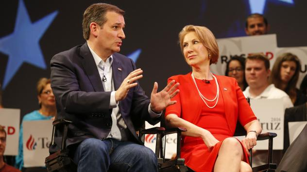 Republican presidential candidate Ted Cruz speaks to Carly Fiorina while taping an interview with Sean Hannity during a campaign stop in Orlando, Fla., last month.