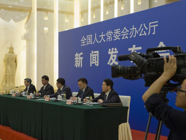 "Chinese officials answer questions about a new law regulating overseas nongovernmental organizations during a press conference at the Great Hall of the People in Beijing on Thursday. The new law subjects NGOs to close police supervision. ""We welcome and"