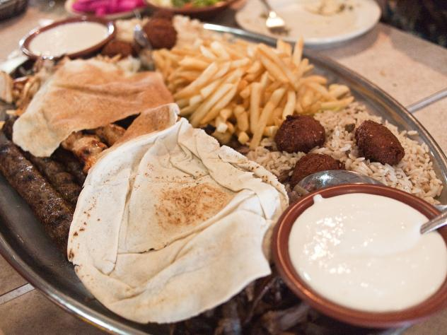 """A platter of falafel, kafta, french fries and other fare at Al Ameer Restaurant in Dearborn, Mich. The Mediterranean eatery will be recognized by the James Beard Awards this year in the """"American Classics"""" category."""