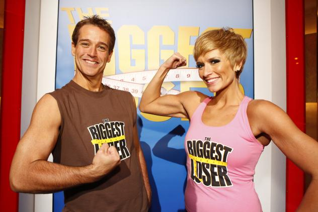 """Danny Cahill, left, won Season 8 of <em>The Biggest Loser</em> in 2009 by losing an amazing 239 pounds. He's pictured with at-home prize winner Rebecca Meyer. In the years since, Cahill has put back on more than 100 pounds, <a href=""""http://www.nytimes.co"""