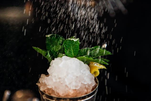 Paul Taylor demonstrates how to make a mint julep and a champagne julep at Southern Efficiency, a D.C. bar owned by mixologist Derek Brown. Here, Taylor pours in simple syrup. (See recipes below.)