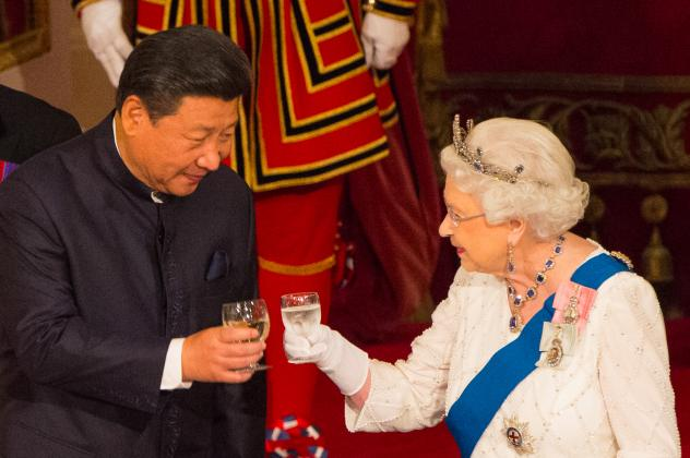 """Chinese President Xi Jinping (left) toasts with Britain's Queen Elizabeth II during a state banquet at Buckingham Palace in London on the first day of the state visit in October 2015. Elizabeth said on camera that Chinese officials had been """"very rude"""" d"""