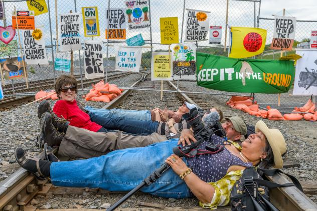 Opponents of oil trains and barges that service the Port of Albany paddle along the Hudson River on Friday in Albany, N.Y. The demonstration was part of the Break Free from Fossil Fuels movement.
