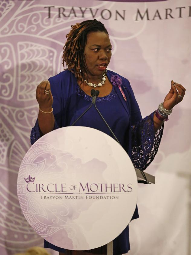 """Queen Thompson Brown, who lost a son to gun violence in 2006, speaks prior to the introduction of Democrat Hillary Clinton at the Trayvon Martin Foundation's """"Circle of Mothers"""" Gala."""
