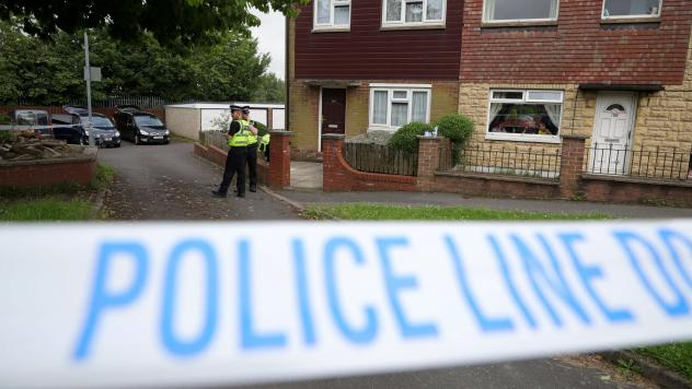 Police cordon off the scene at the suspect's home after Jo Cox, 41, Labour MP for Batley and Spen, was killed by an attacker Thursday in Birstall, England.