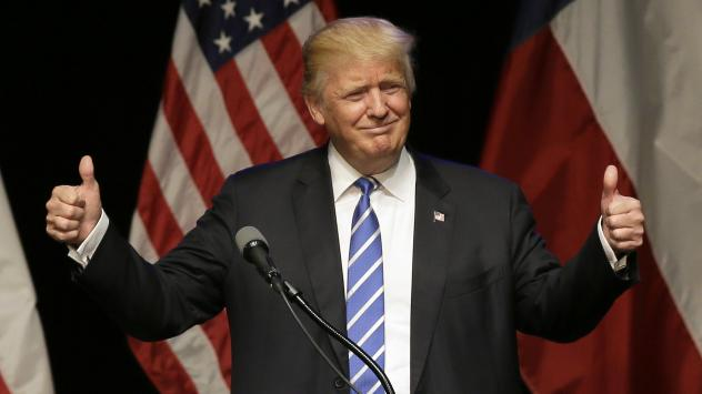 Presumptive Republican presidential nominee Donald Trump flashes two thumbs up during a rally at Gilley's in Dallas on Thursday.