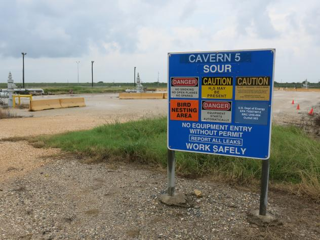Robert Corbin (left), deputy assistant energy secretary for the Office of Petroleum Reserves, speaks at the Bryan Mound site near Freeport, Texas, on June 9. He says the Strategic Petroleum Reserve fills a vital economic role.