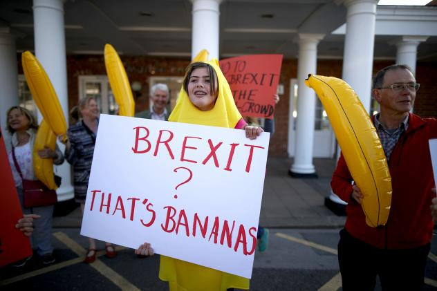 """Anti-Brexit supporters dressed as bananas protest outside a racecourse in York, England. """"It is absolutely crazy that the EU is telling us what shape our bananas have got to be,"""" says Brexit's foremost cheerleader, Boris Johnson, the former mayor of Lond"""