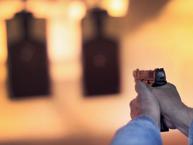 A marksman sights in on a target during a class for an Illinois concealed carry permit on February 2014.