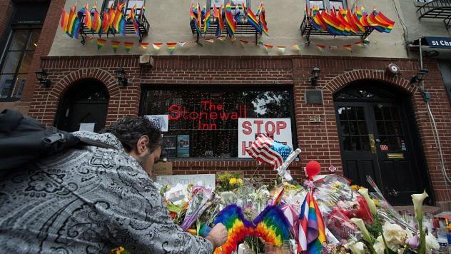 People light candles at a memorial to the Orlando shooting victims outside the Stonewall Inn last week in New York.