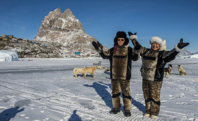 U.N. Secretary-General Ban Ki-moon (left) and Greenland's then-Prime Minister Aleqa Hammond stand on the ice outside the city of Uummannaq, north of the Arctic Circle, in 2014. Greenland held a referendum in 1982 and voted to leave the European Economic