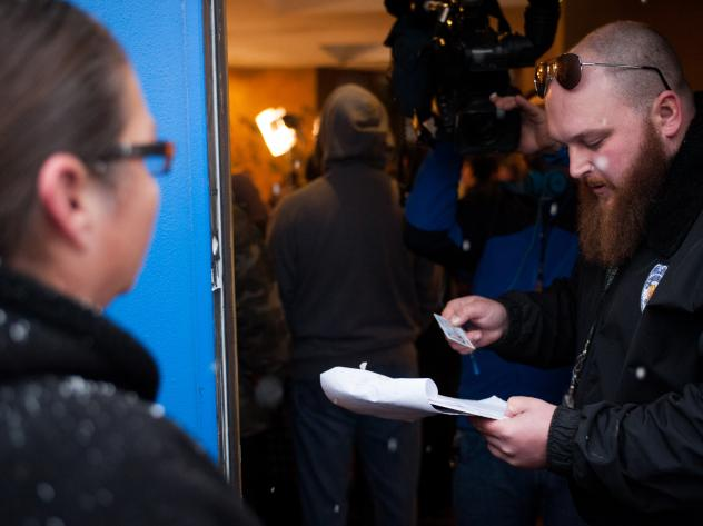 Kurt Britz checks a driver's license at the 3-D Denver Discrete Dispensary on January 1, 2014, the first day recreational marijuana sales were legal in Colorado. Possession remains illegal for those under 21 years old, and statistics show a widening raci