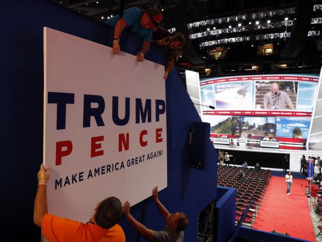 Workers place a sign Sunday as they prepare for the Republican National Convention this week in Cleveland.