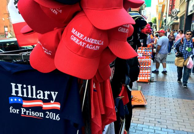 """Vendor Larry Rich agrees with the message of the merchandise he sells in Cleveland. """"I'm with Trump all the way,"""" he says."""