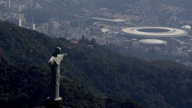 An aerial view shows Christ the Redeemer with Maracana Stadium in the background on July 4 in Rio de Janeiro.