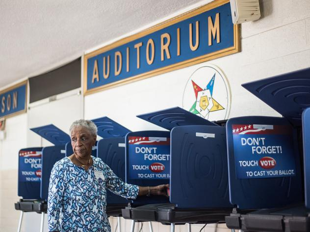 A poll worker prepares a voting machine before the South Carolina primary. The recent hacking of the Democratic Party databases has raised questions about potential issues with voting systems.