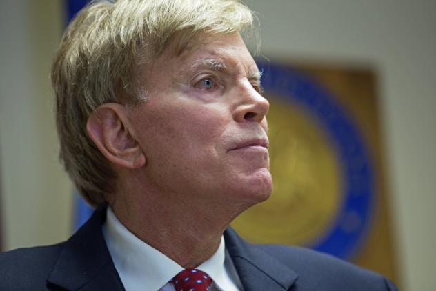 """Former Ku Klux Klan leader David Duke talks to the media at the Louisiana secretary of state's office in Baton Rouge, La., on July 22, after registering to run for the U.S. Senate. """"The climate of this country has moved in my direction,"""" Duke said as he"""