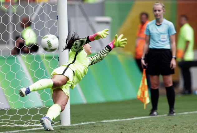 """U.S. goalkeeper Hope Solo fails to stop a shot during a penalty shootout in the quarter-final match with Sweden. The Swedes won the the shootout, knocking the Americans out of the tournament. Afterward, Solo called the Swedes """"cowards."""""""