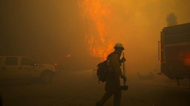 A firestorm engulfs the Mormon Rocks area in the San Bernardino National Forest off State Highway 138 in Phelan, Calif., as the Bluecut Fire rages out of control Tuesday afternoon.