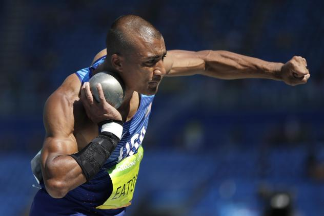 Eaton (left) competes Wednesday in the 100 meters, the first of the 10 events in the decathlon. His time was 10.46. Estonia's Karl Saluri is in the center, while Canada's Damian Warner (right) had the fastest time in the event, 10.35. Warner is considere