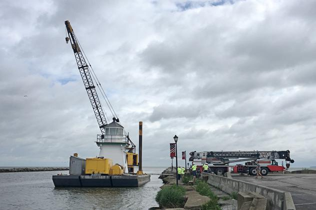 Port Clinton Lighthouse is moved to its original location on Lake Erie in Port Clinton, Ohio, after spending 60 years at a private marina on the Portage River.