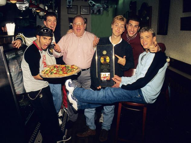 Lou Pearlman (center) poses with *NSYNC Chris Kirkpatrick, JC Chasez, Lance Bass, Joey Fatone and Justin Timberlake at N.Y.P.D. pizza in Miami, circa 1996.