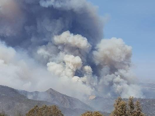 Ten thousand fire personnel are battling blazes across California, including in San Luis Obispo County, where the massive Chimney Fire threatens homes and the historic Hearst Castle.