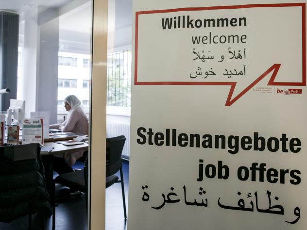 Job consultant Saskia Ben jemaa sits in a welcome center for immigrants on Aug. 18 in Berlin. The center assists immigrants and refugees with asylum status in finding jobs, housing and qualification recognition of their previous employment and education.