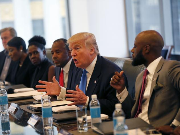 Republican presidential candidate Donald Trump holds an August roundtable meeting with the Republican Leadership Initiative in his offices at Trump Tower in New York. Dr. Ben Carson is seated next to Trump at center.