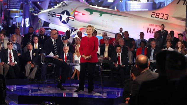 NBC's Matt Lauer looks on as Democratic presidential nominee Hillary Clinton speaks during the Commander-in-Chief Forum in New York City Wednesday evening.