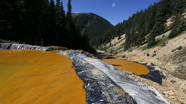 Water flows through a series of sediment retention ponds in August 2015 that were built to contain heavy metal and chemical contaminants from the Gold King Mine wastewater accident in Colorado. That site, and 47 others in southwest Colorado, were declare