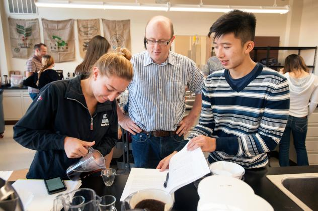 Associate professor William Ristenpart talks with Sabrina Perell, a community regional development major, and Kyle Phan, an undeclared major, about the taste of their brew during the Design of Coffee class last October at UC Davis. Students learn the sci