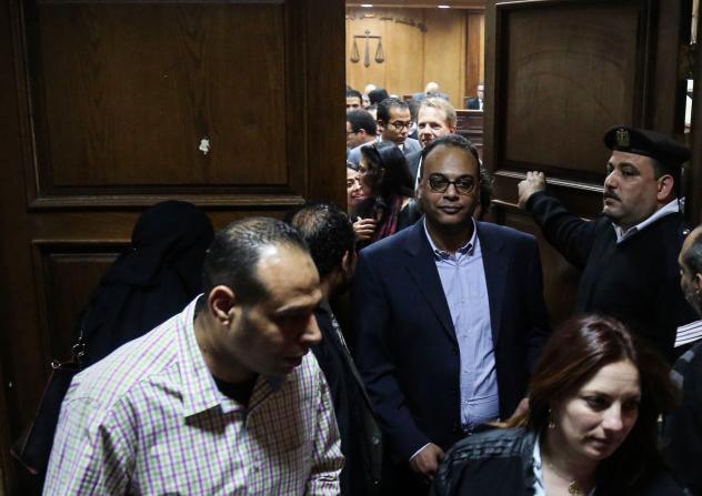Investigative journalist Hossam Baghat (center), who founded the Egyptian Initiative for Personal Rights, leaves a courtroom at the Cairo Criminal Court in March.