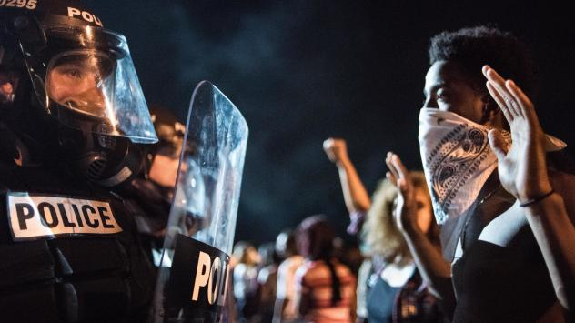 Protesters throw objects at police officers on I-85 in Charlotte, N.C., in the early hours of Wednesday morning.