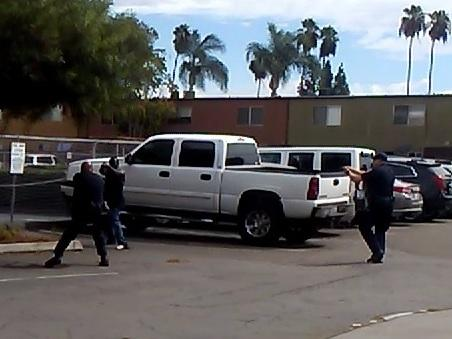 Police in El Cajon, Calif., provided this image, which they say is a still from a bystander's cellphone video of the shooting of an unarmed black man on Tuesday. Police say the man was pointing an object — which was not a weapon — at an officer.