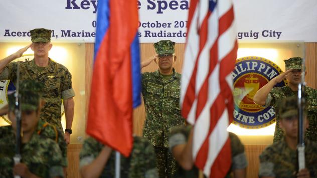 U.S. Marines Brig. Gen. John Jansen (left), Philippines marines Maj. Gen. Andre Costales (center) and Brig. Gen. Maximo Ballesteros salute during the opening ceremony of the Amphibious Landing Exercise in Manila on Tuesday. The Philippines and the U.S. l
