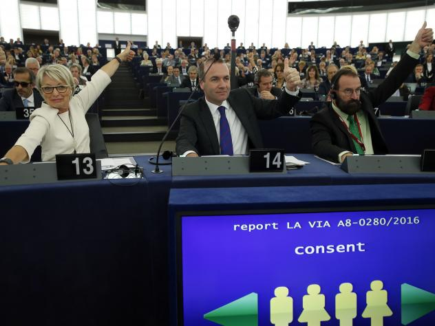 European lawmakers (left to right) Francoise Grossetete of France, Manfred Weber of Germany and Jozsef Szajer of Hungary vote in favor of the Paris climate change agreement on Tuesday.
