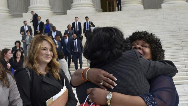 Christina Swarns, center, the lead counsel for Duane Buck, is embraced by Buck's stepsister Phyllis Taylor, right, outside of the U.S. Supreme Court on Oct. 5 in Washington, D.C.