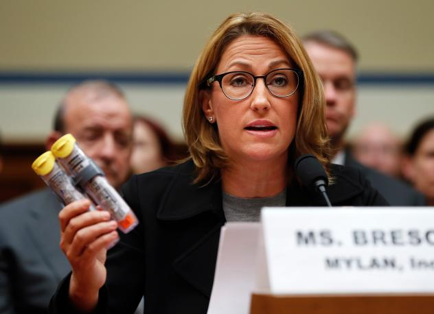 Mylan CEO Heather Bresch holds up an EpiPen two-pack while testifying about price increases to the House Oversight and Government Reform Committee on Sept. 21.