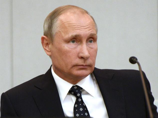 Russian President Vladimir Putin listens during the opening session of the newly elected State Duma, Russia's lower house of parliament, in Moscow. The U.S. blamed the Russian government for the hacking of American political sites and accused Moscow of t