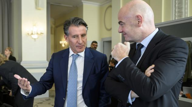 IAAF President Sebastian Coe, left, speaks with FIFA President Gianni Infantino at the opening of an Olympic Summit in Lausanne, Switzerland, Saturday. Olympic sports leaders are discussing how to improve a global anti-doping system amid the fallout of a