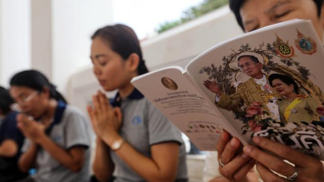 People pray for Thai King Bhumibol Adulyadej at Wat Pathum Wanaram temple on Monday in Bangkok. The health of Thailand's 88-year-old monarch has deteriorated, the palace said Sunday night.