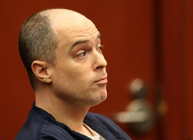 Defendant Matthew Apperson reacts to testimony from George Zimmerman during a September court hearing in Sanford, Fla.