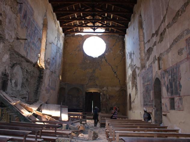 Italy's police art squad worked alongside structural engineers with the fire department to rescue works from the Basilica of Sant'Agostino, a cherished church in Amatrice, shown here on Aug. 24 after being damaged by a magnitude 6.1 earthquake. Firemen w