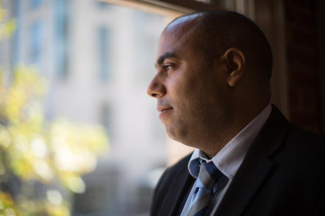 Ronny Marty, who's from the Dominican Republic, came to the U.S. with the promise of a job. He ended up living in a tiny apartment with three men, with most of his earnings going back to his employer.
