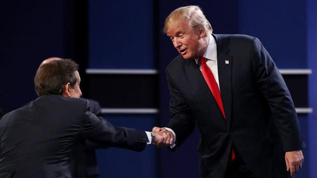 Republican presidential nominee Donald Trump shakes hands with Fox News anchor and moderator Chris Wallace after the third presidential debate.