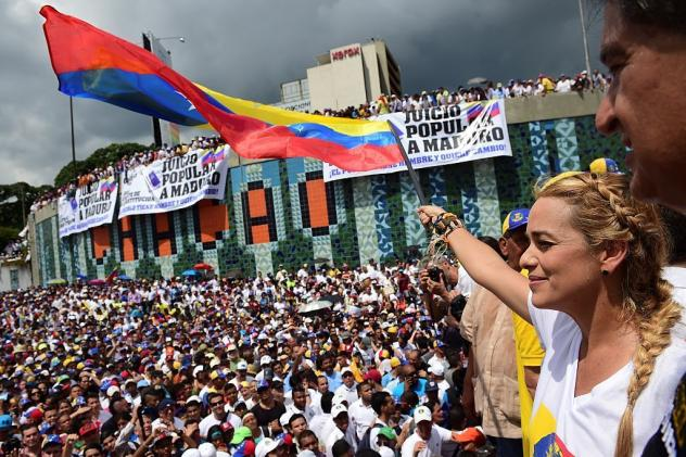 People demonstrate against the government of Venezuelan President Nicolas Maduro in Caracas on Wednesday.