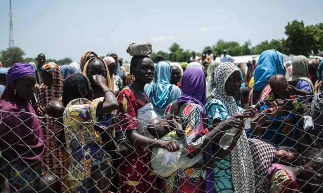 Women and children line up for food in one of the camps for displaced persons in Nigeria. The photo was taken on September 15, 2016.